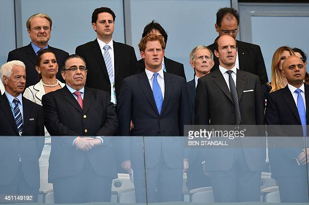 Britain's Prince Harry stands with officials as national anthems are played ahead of the Group D football match between Costa Rica and England at The...