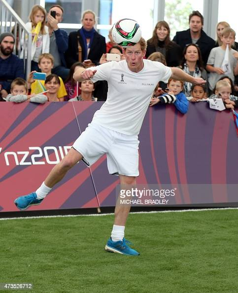 Britain's Prince Harry Takes Part In A Football
