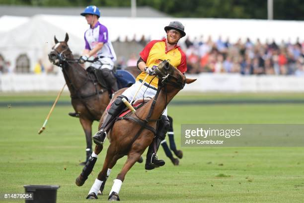 Britain's Prince Harry takes part in the the Jerudong Park Trophy Final at Cirencester Park Polo Club central England on July 15 2017 RATCLIFFE