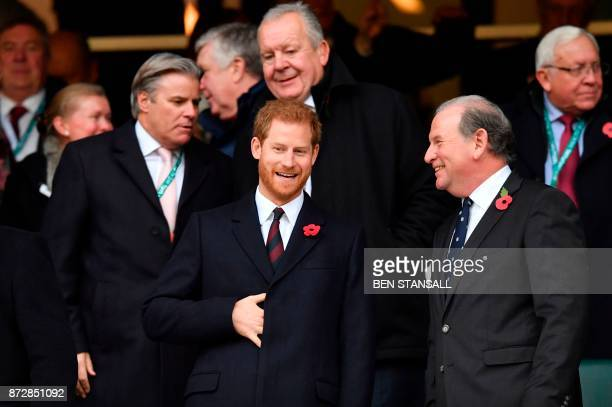 Britain's Prince Harry talks with another guest in the crowd ahead of kick off of the Autumn international rugby union test match between England and...