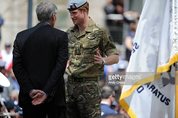 Britain's Prince Harry talks with U.S. Senator, Mark Udall, D-Colorado, after the opening ceremonies for the 2013 Warrior Games wrapped up at the...