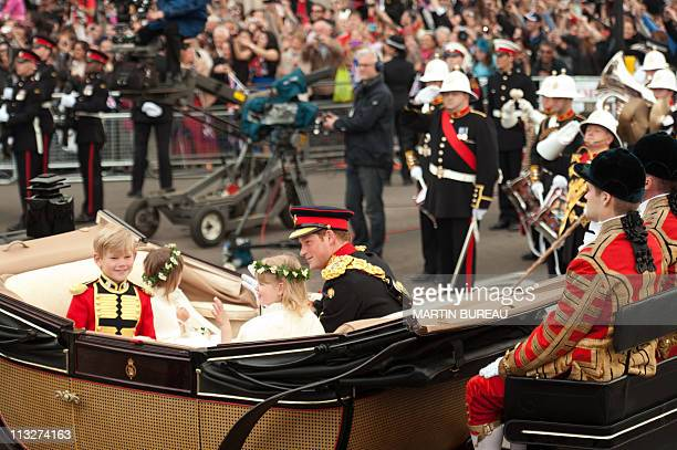 Britain's Prince Harry the Bridesmaids and Page Boys travel in an Ascot Landau carriage along the Processional Route to Buckingham Palace after the...