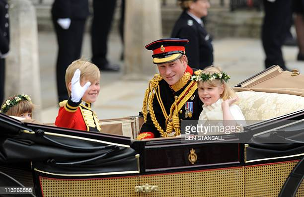 Britain's Prince Harry travels with two of the bridesmaids and a page boy in an Ascot Landau carriage along the Processional Route to Buckingham...