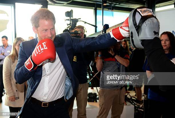 Britain's Prince Harry tries out boxing at the launch of the Heads Together campaign on mental health at the Olympic park in London on May 16 2016...