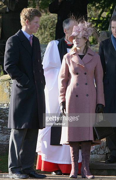 Britain's Prince Harry waits on family members after attending the Christmas Day service at Sandringham Church on December 25 2004 in King's Lynn...