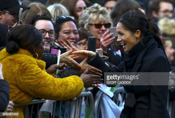 Britain's Prince Harry's fiancée US actress Meghan Markle greets wellwishers on arrival at Cardiff Castle in Cardiff south Wales on January 18 for a...