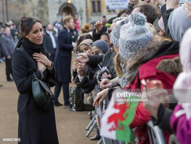 TOPSHOT Britain's Prince Harry's fiancée US actress Meghan Markle greets wellwishers on arrival at Cardiff Castle in Cardiff south Wales on January...