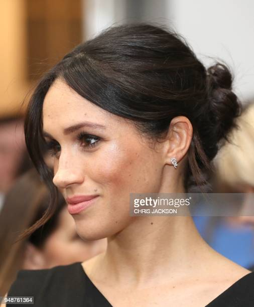 Britain's Prince Harry's fiancee US actress Meghan Markle attends a reception for Women's Empowerment at the Royal Aeronautical Society in central...