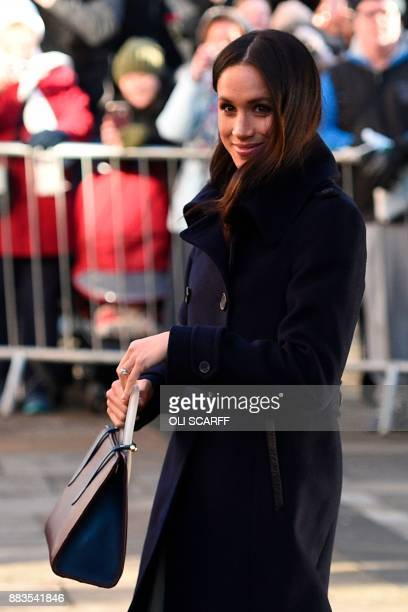 Britain's Prince Harry's fiancee US actress Meghan Markle gestures on leaving an engagement at Nottingham Contemporary in Nottingham, central...