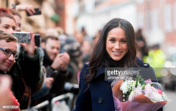 Britain's Prince Harry's fiancee US actress Meghan Markle greets wellwishers on a walkabout as they arrive for an engagement at Nottingham...