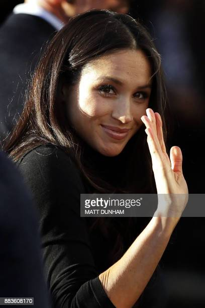 Britain's Prince Harry's fiancee US actress Meghan Markle waves a she leaves after watching a hip hop opera performed by young people involved in the...