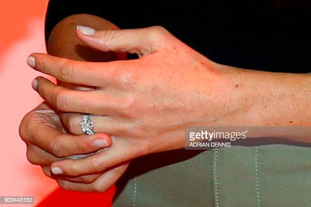 Britain's Prince Harry's fiancee US actress Meghan Markle wears her engagement ring as they visit the HIV/AIDS at the Terrence Higgins Trust World...