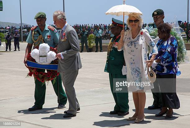 Britain's Prince of Wales and his wife Camilla lay wreaths at the Memorial in Remembrance Park in Port Moresby on November 5 2012 Papua New Guinea is...