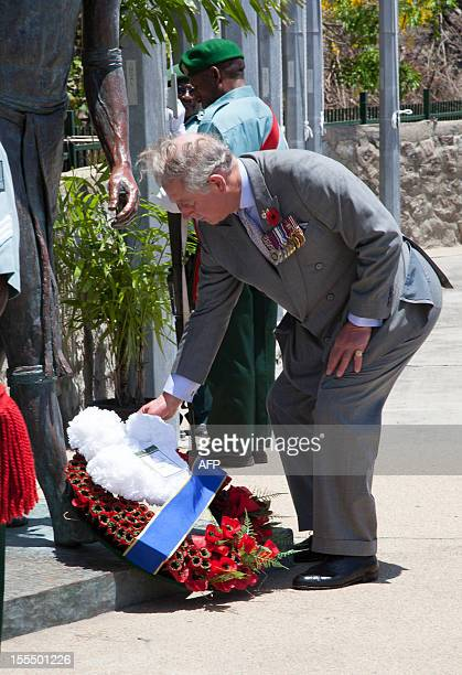 Britain's Prince of Wales lays a wreath at the Memorial in Remembrance Park in Port Moresby on November 5 2012 Papua New Guinea is the first stop on...