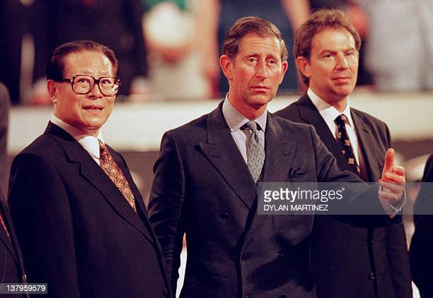 Britain's Prince of Wales shows the way to Chinese President Jiang Zemin as British Prime Minister Tony Blair follows at the end of the ceremony...