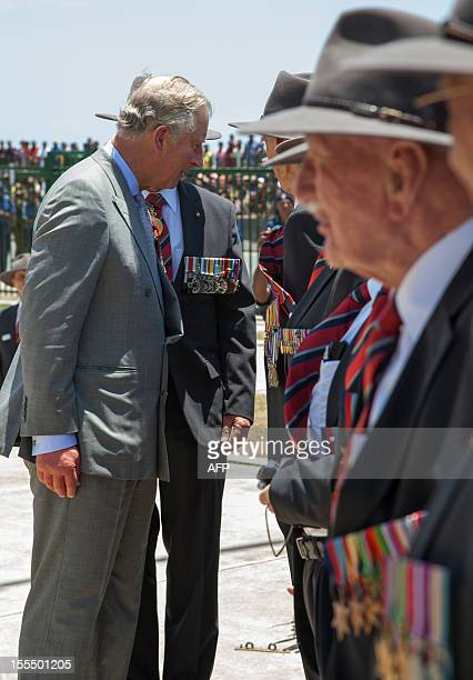 Britain's Prince of Wales speaks to Australian WWII Kokoda Trail veterans after laying wreaths at the Memorial in Remembrance Park in Port Moresby on...