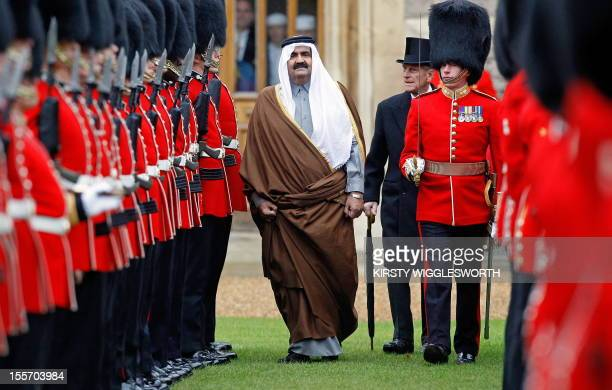 Britain's Prince Philip and Qatar's emir Sheikh Hamad bin Khalifa alThani review a Guard of Honour in the quadrangle at Windsor Castle in Windsor...