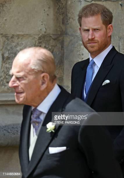 Britain's Prince Philip Duke of Edinburgh and Britain's Prince Harry Duke of Sussex leave St George's Chapel in Windsor Castle Windsor west of London...