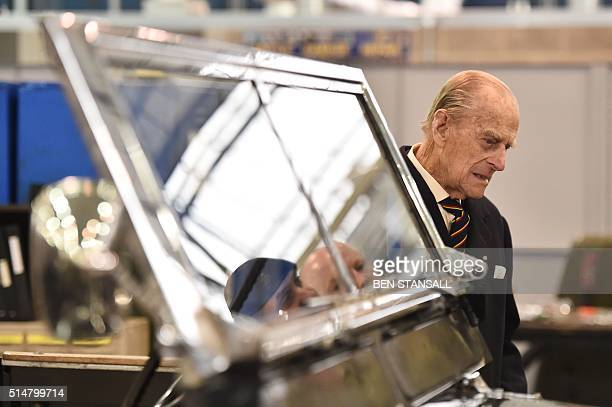 Britain's Prince Philip, Duke of Edinburgh, Colonel-in-Chief, Royal Electrical and Mechanical Engineers , looks at a Black 1960s ceremonial Land...