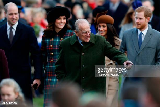 Britain's Prince Philip Duke of Edinburgh gestures as he is followed by Britain's Prince William Duke of Cambridge Britain's Catherine Duchess of...