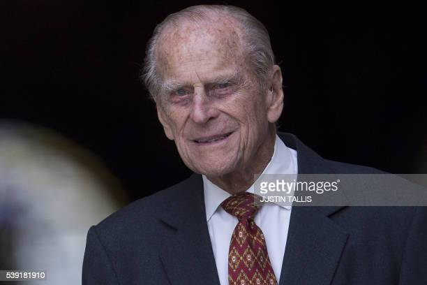Britain's Prince Philip, Duke of Edinburgh leaves after attending a national service of thanksgiving for the 90th birthday of Britain's Queen...