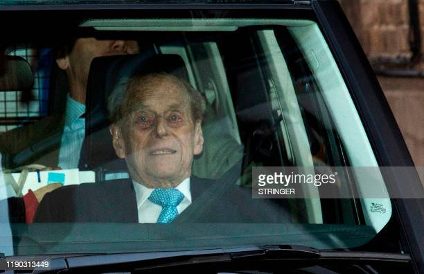 TOPSHOT Britain's Prince Philip Duke of Edinburgh leaves the King Edward VII hospital in west London on December 24 2019 Britain's Prince Philip left...