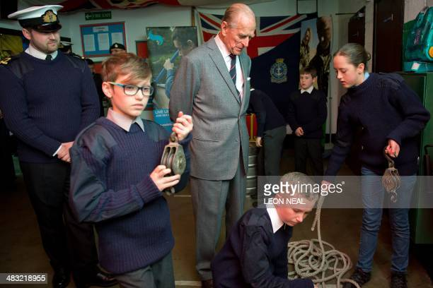 Britain's Prince Philip Duke of Edinburgh meets cadets at the Windsor Sea Cadet Unit opening in Windsor Berkshire West of London on April 7 2014 The...