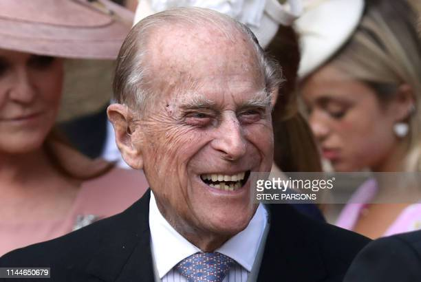 Britain's Prince Philip Duke of Edinburgh reacts as he talks with Britain's Prince Harry Duke of Sussex as they leave St George's Chapel in Windsor...