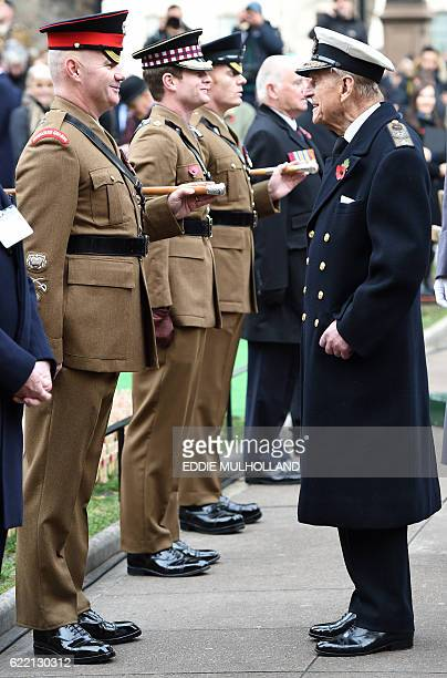 Britain's Prince Philip Duke of Edinburgh reacts as he visits the Field of Remembrance at Westminster Abbey in central London on November 10 2016...