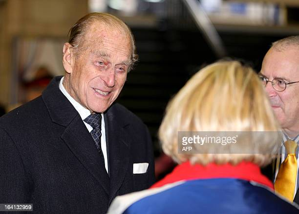 Britain's Prince Philip Duke of Edinburgh speaks with a Transport of London employee during a visit with Britain's Queen Elizabeth II to Baker Street...