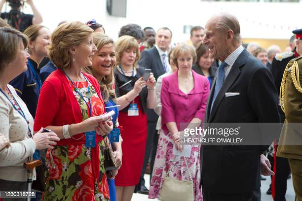 Britain's Prince Philip, Duke of Edinburgh talks with members of the public as he accompanies Britain's Queen Elizabeth II to officially open Central...