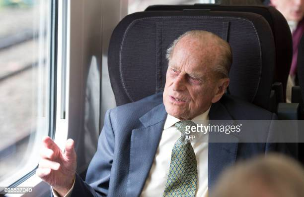 Britain's Prince Philip Duke of Edinburgh travels on a Great Western Railway train to mark the 175th anniversary of the first train journey by a...