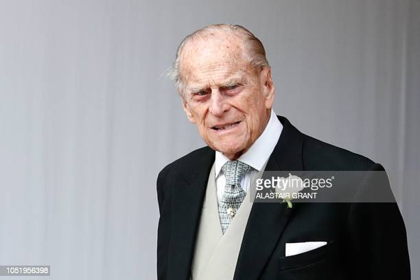 Britain's Prince Philip Duke of Edinburgh waits for the carriage carrying Princess Eugenie of York and her husband Jack Brooksbank to pass at the...