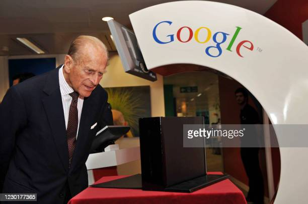 Britain's Prince Philip is pictured during his visit to Google's UK headquarters with Queen Elizabeth II, in London, on October 16, 2008. Britain's...