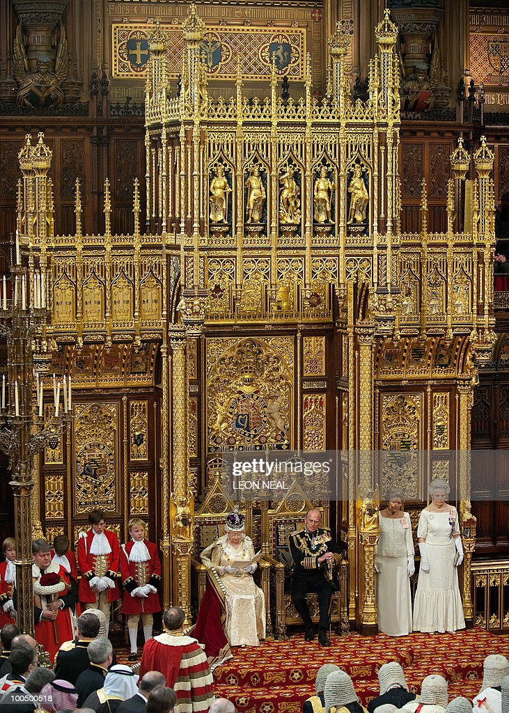 Britain's Prince Philip (3rd R), listens as his wife, Queen Elizabeth II (C) speaks during her address to the House of Lords, during the State Opening of Parliament in Westminster, central London on May 25, 2010. Britain's Queen Elizabeth II set out the new coalition government's legislative programme on Tuesday in a ceremony of pomp and history following the closest general election for decades. AFP PHOTO/Leon Neal/Pool