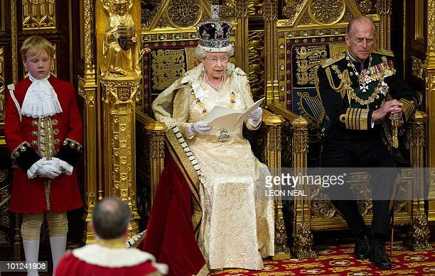 Britain's Prince Philip listens as his wife Queen Elizabeth II speaks during her address to the house of Lords during the State Opening of Parliament...