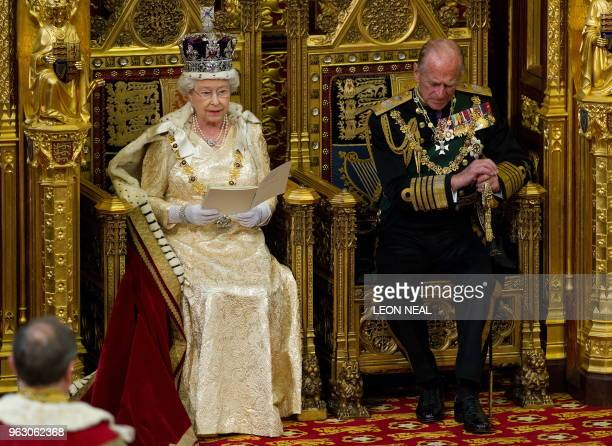 Britain's Prince Philip , listens as his wife, Queen Elizabeth II speaks during her address to the House of Lords, during the State Opening of...