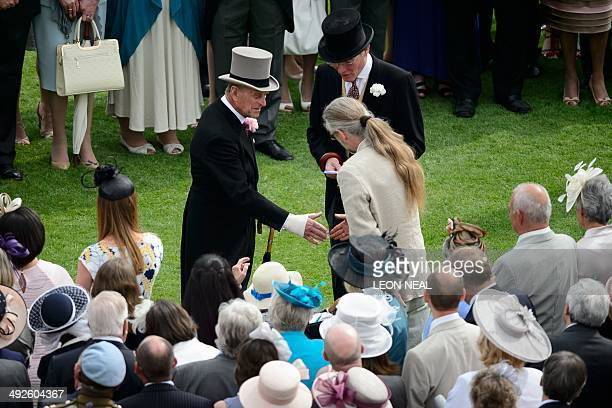 Britain's Prince Philip The Duke of Edinburgh meets guests at the first garden party of the season in the grounds of Buckingham Palace in central...