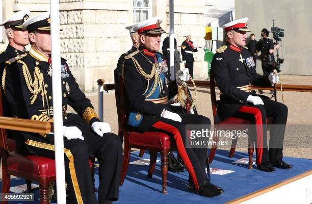 Britain's Prince Philip, The Duke of Edinburgh sits with First Sea Lord Admiral Sir George Zambellas and Commandant General of the Royal Marines...