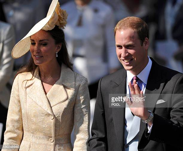 Britain's Prince William and Catherine, Duchess of Cambridge, leave after they attended the wedding between England rugby player Mike Tindall and...