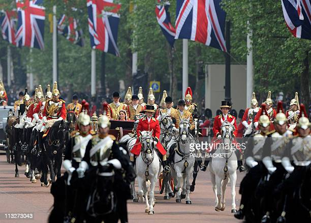 Britain's Prince William and Catherine Duchess of Cambridge travel to Buckingham Palace in the 1902 State Landau along the Procession Route after...