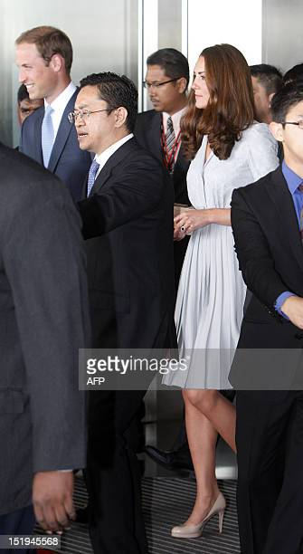 Britain's Prince William and Catherine the Duchess of Cambridge arrive at the Kuala Lumpur International Airport in Sepang on September 13 2012...