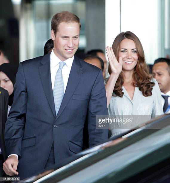 Britain's Prince William and Catherine the Duchess of Cambridge arrive at Kuala Lumpur International Airport in Sepang on September 13 2012 Britain's...
