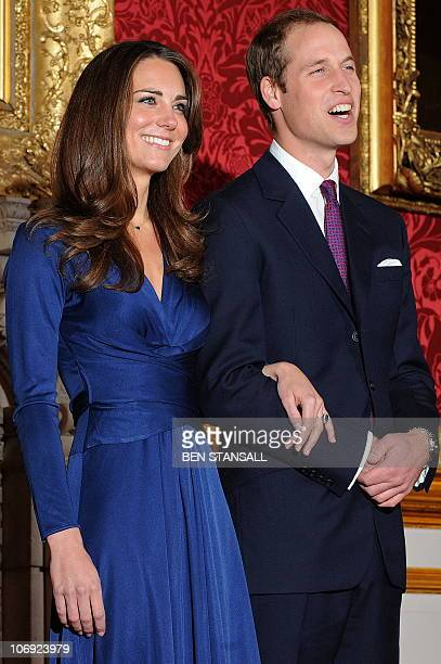 Britain's Prince William and his fiancée Kate Middleton pose for photographers during a photocall to mark their engagement in the State Rooms of St...