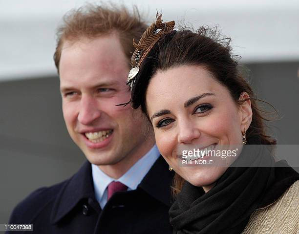 Britain's Prince William and his fiancee Kate Middleton smile following a naming ceremony and service of dedication for the Royal National Lifeboat...
