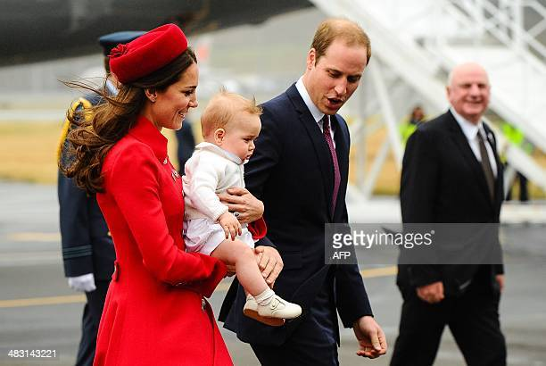 Britain's Prince William and his wife Catherine carrying baby Prince George arrive at the international airport in Wellington on April 7 2014 William...