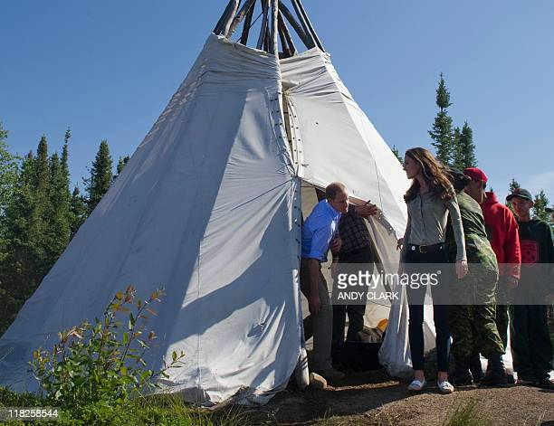 Britain's Prince William and his wife Catherine Duchess of Cambridge exit a teepee at Blatchford Lodge Northwest Territories July 5 2011 The Prince...