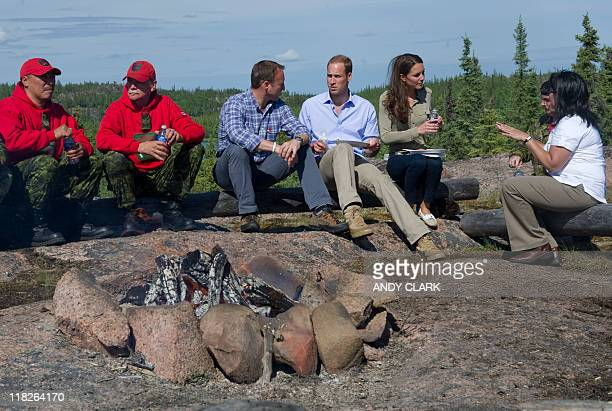 Britain's Prince William and his wife Catherine Duchess of Cambridge eat a lunch of Arctic Char while Blatchford Lake Northwest Territories July 5...