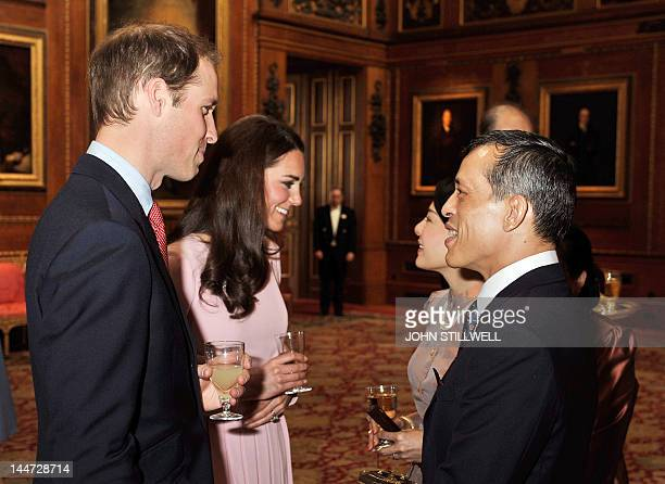 Britain's Prince William and his wife Catherine Duchess of Cambridge spaek with Thai Crown Prince Maha Vajiralongkorn and Princess Srirasmi at...