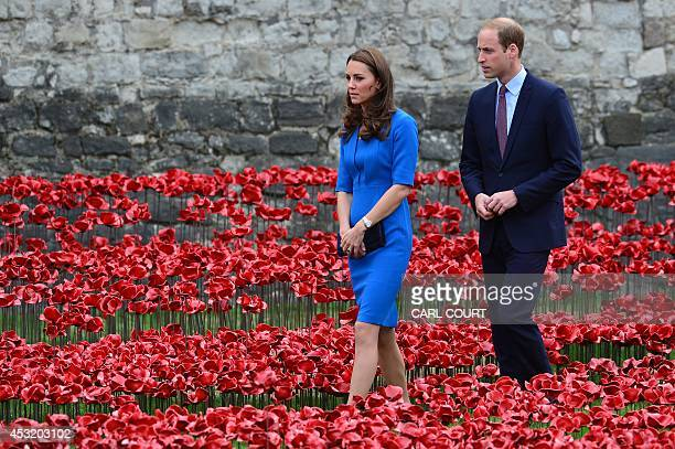 Britain's Prince William and his wife Catherine, Duchess of Cambridge, are pictured as they visit the Tower of London's 'Blood Swept Lands and Seas...